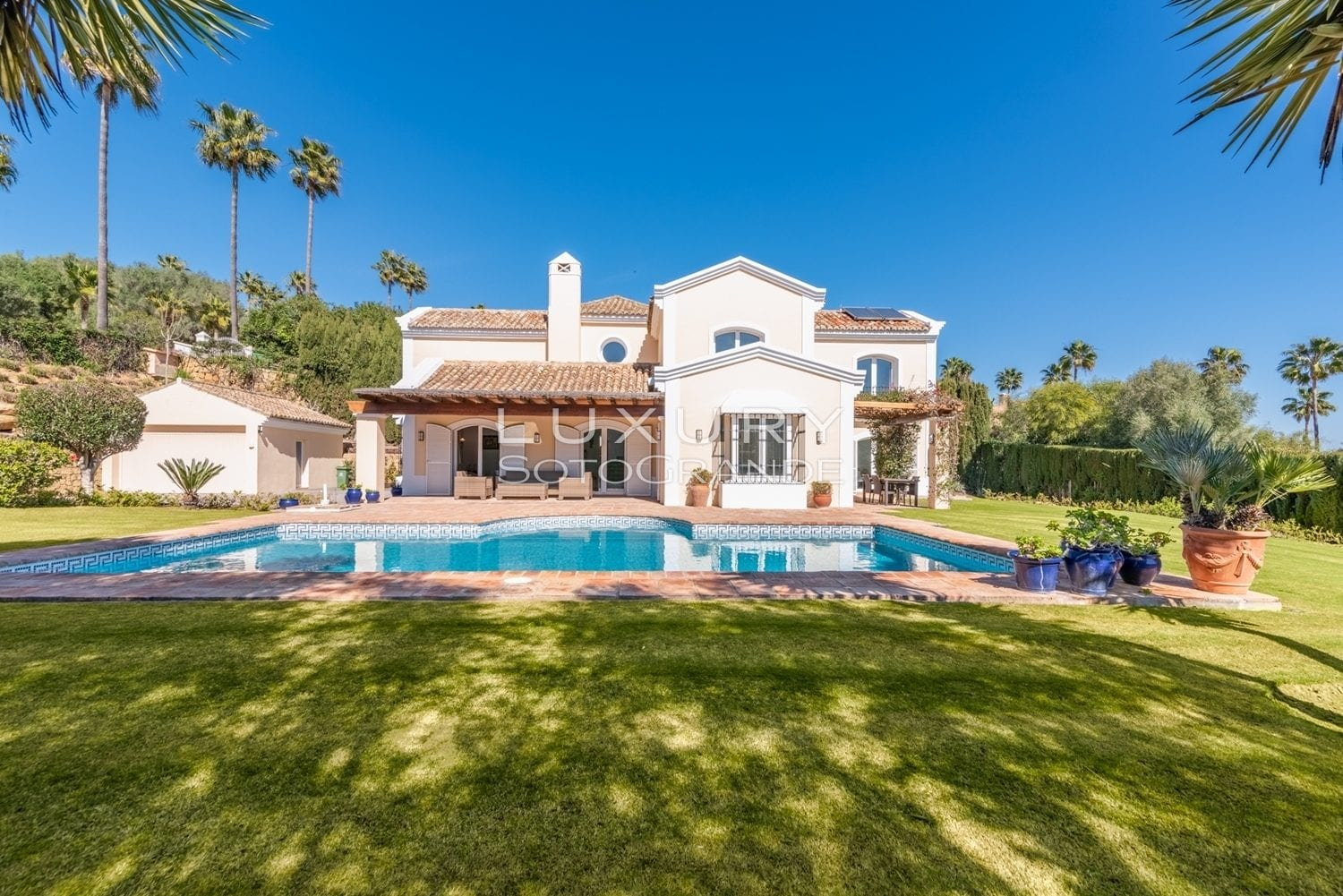 A charming contemporary style family villa with pretty south facing private gardens and lovely views to 2 golf courses